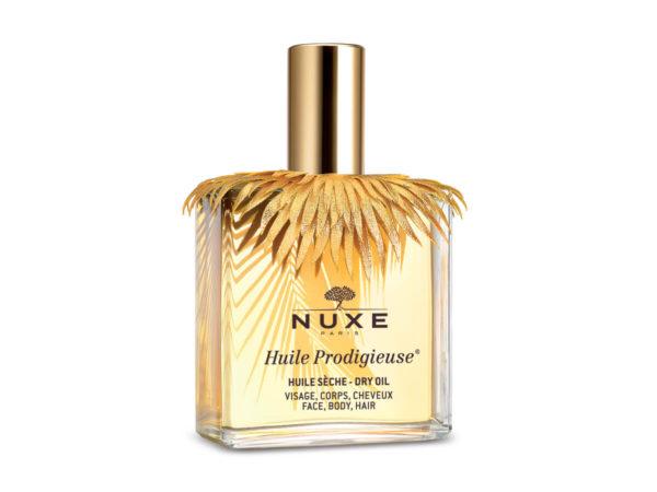 cape en textile façon lamé or, Huile Prodigieuse de Nuxe, ouvragées au laser